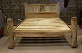 A LIMED OAK BEDSTEAD OF GOTHIC DESIGN