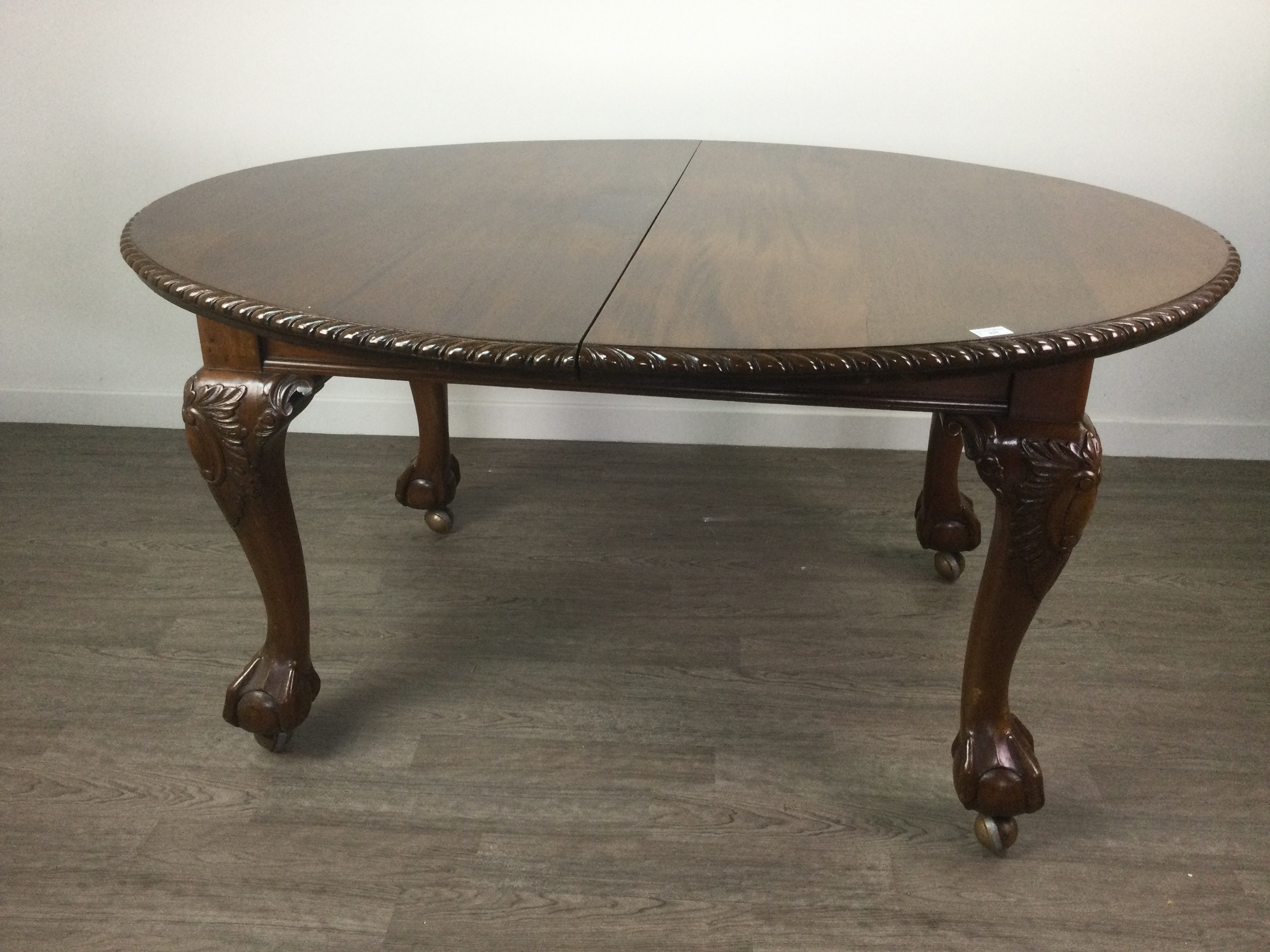 A MAHOGANY DINING TABLE OF CHIPPENDALE DESIGN - Image 2 of 2
