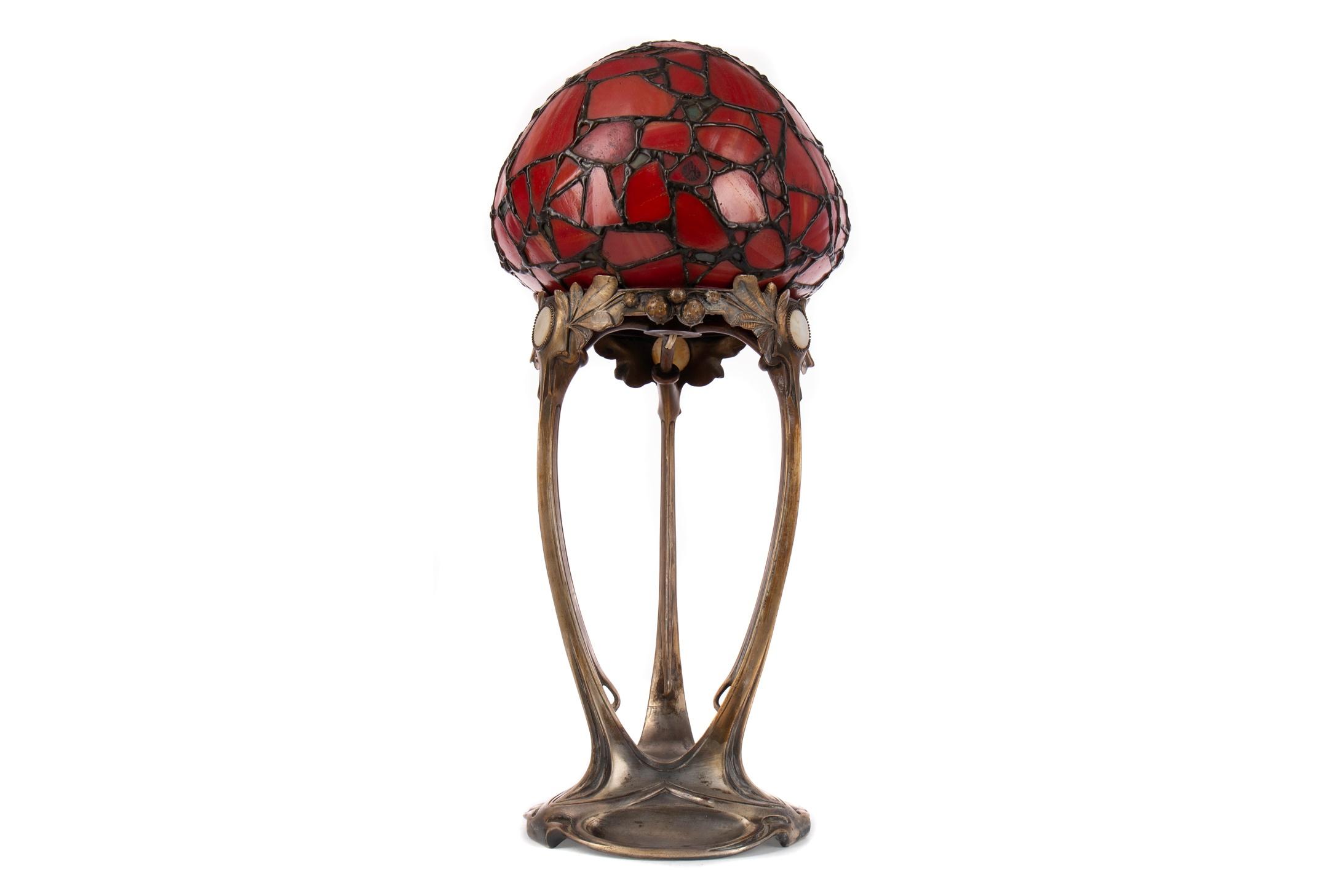 AN ART NOUVEAU TABLE LAMP