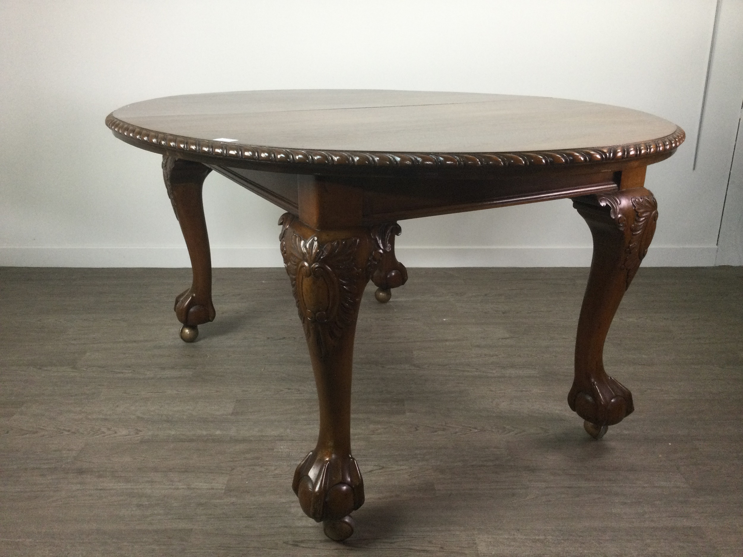 A MAHOGANY DINING TABLE OF CHIPPENDALE DESIGN