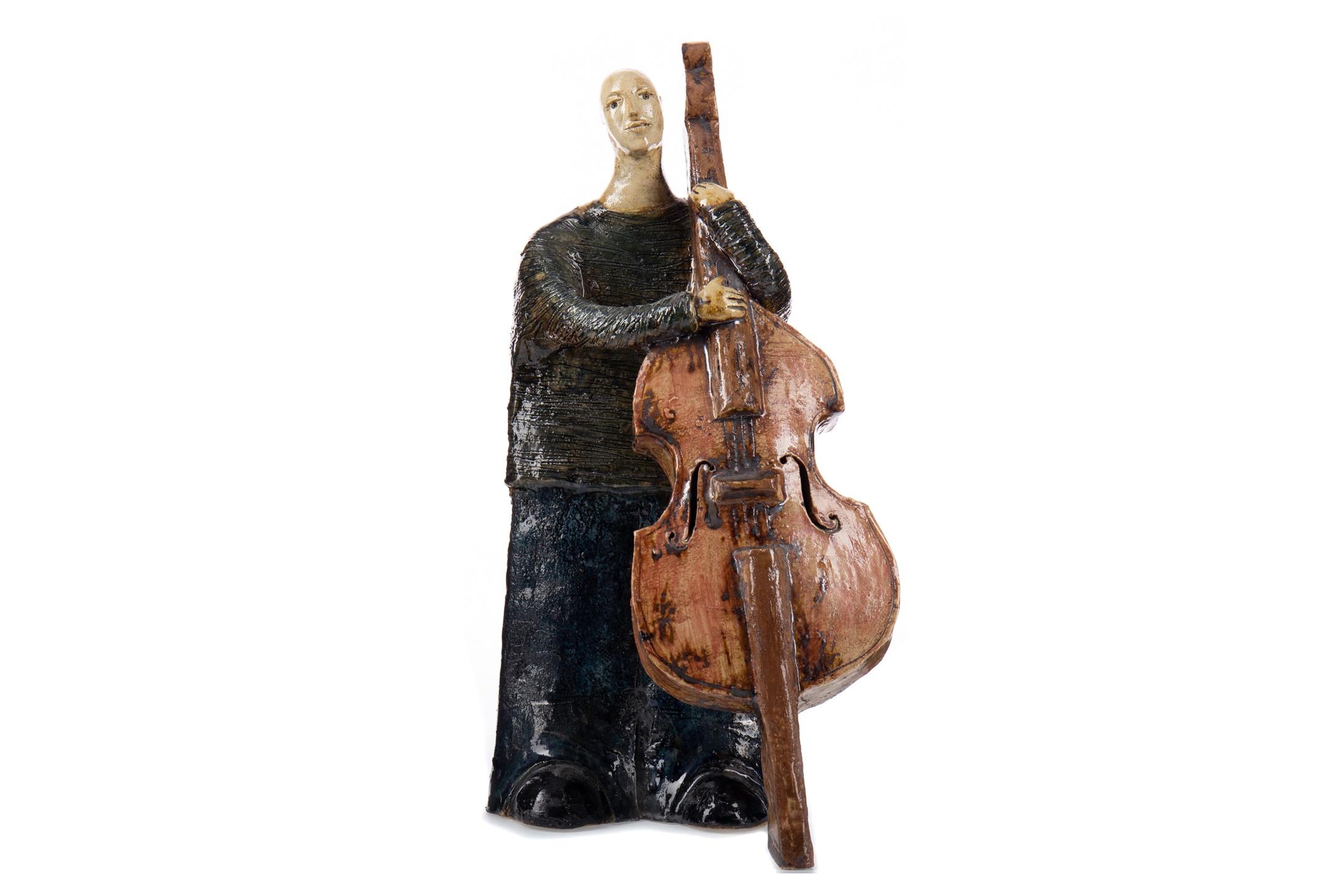 MUSICIAN, A SCULPTURE BY LUDMILLA KOSIMA