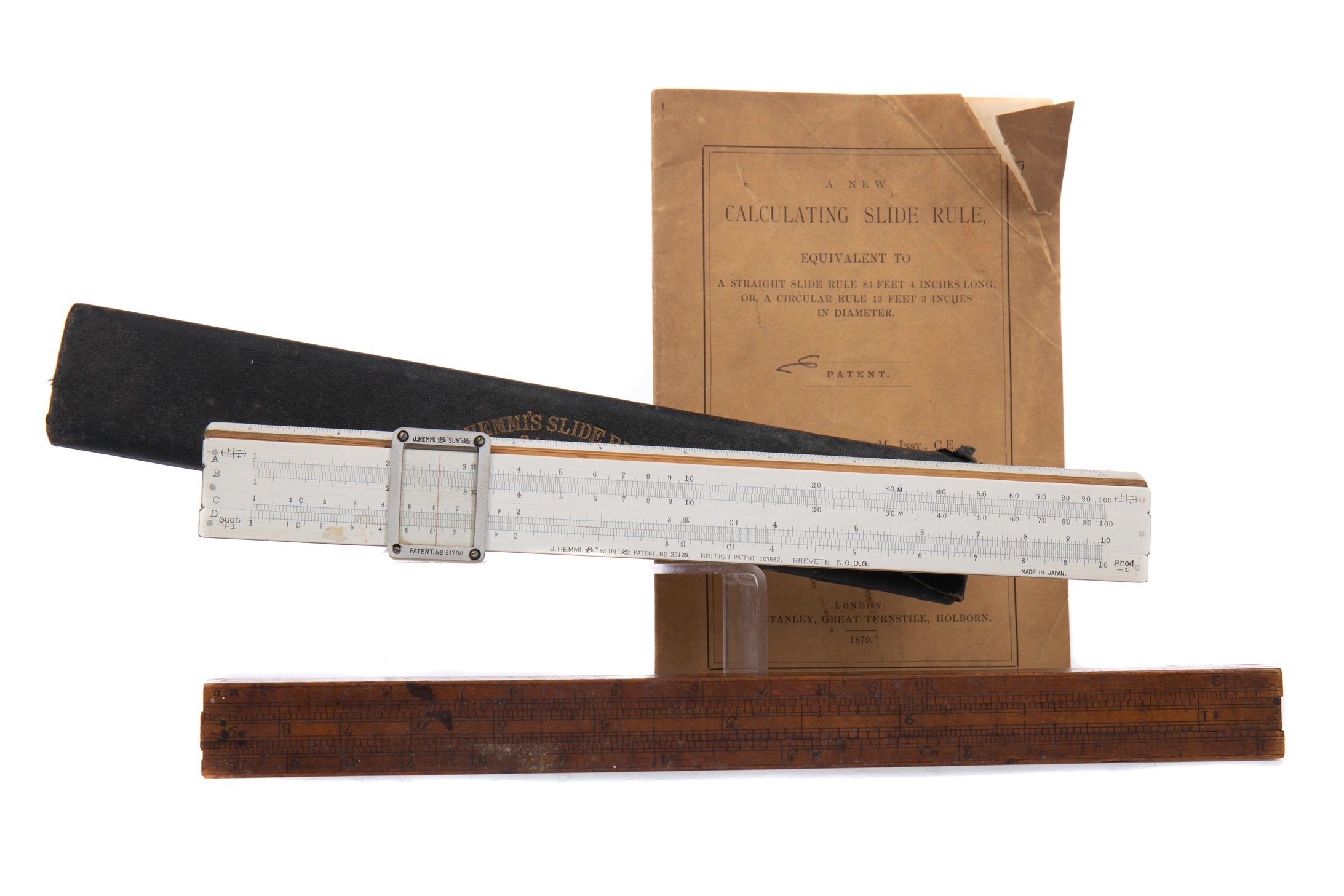 A 19TH CENTURY CALCULATING SLIDE RULE BY W.F. STANLEY AND ANOTHER