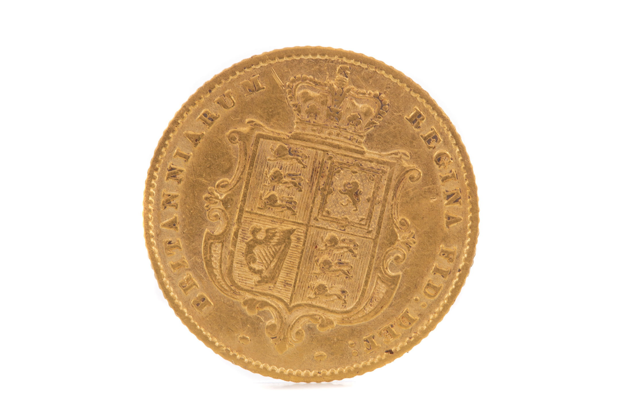 A VICTORIA GOLD HALF SOVEREIGN DATED 1853