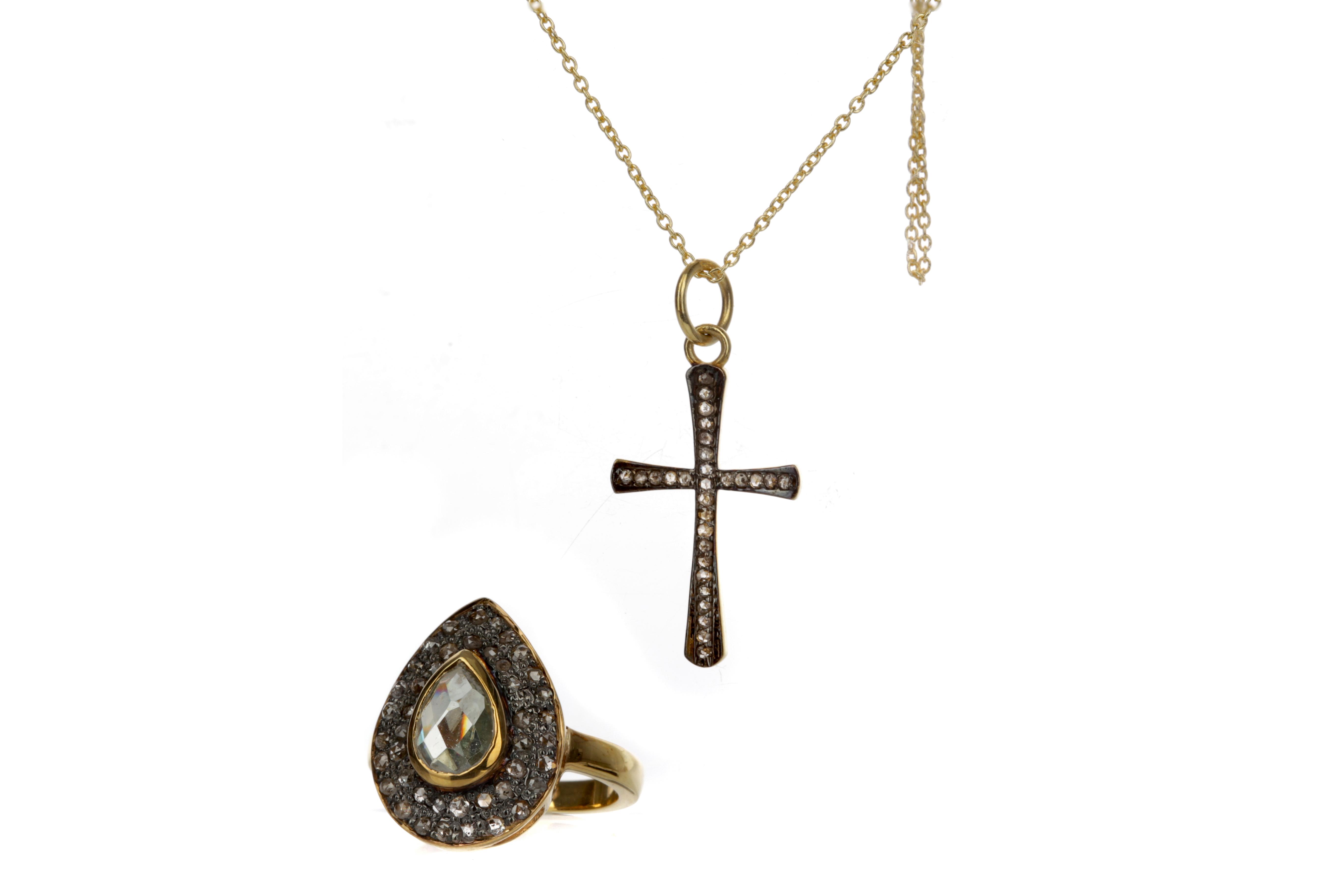 A MOISSANITE RING AND DIAMOND CROSS PENDANT