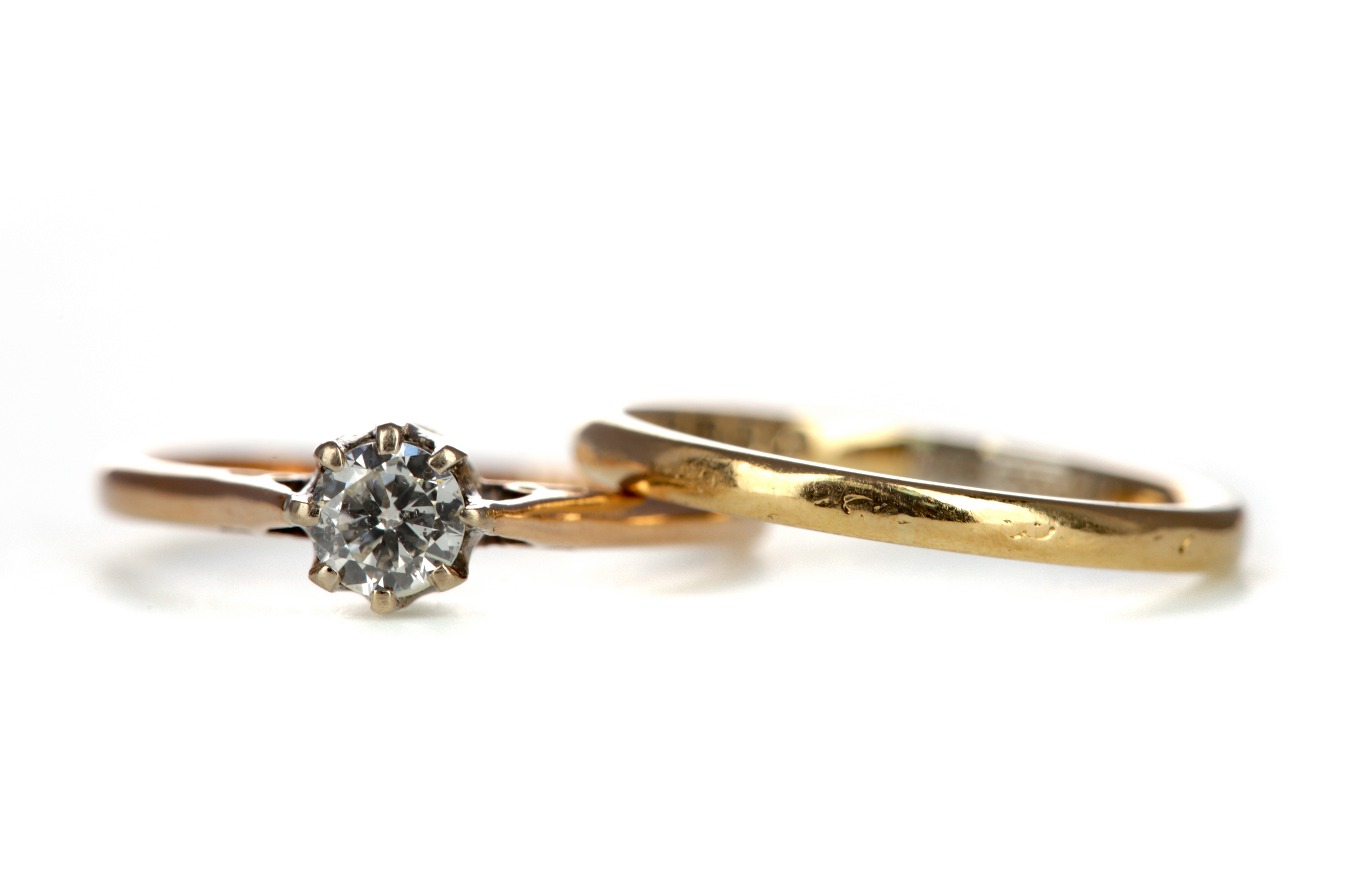 A DIAMOND RING AND A WEDDING BAND