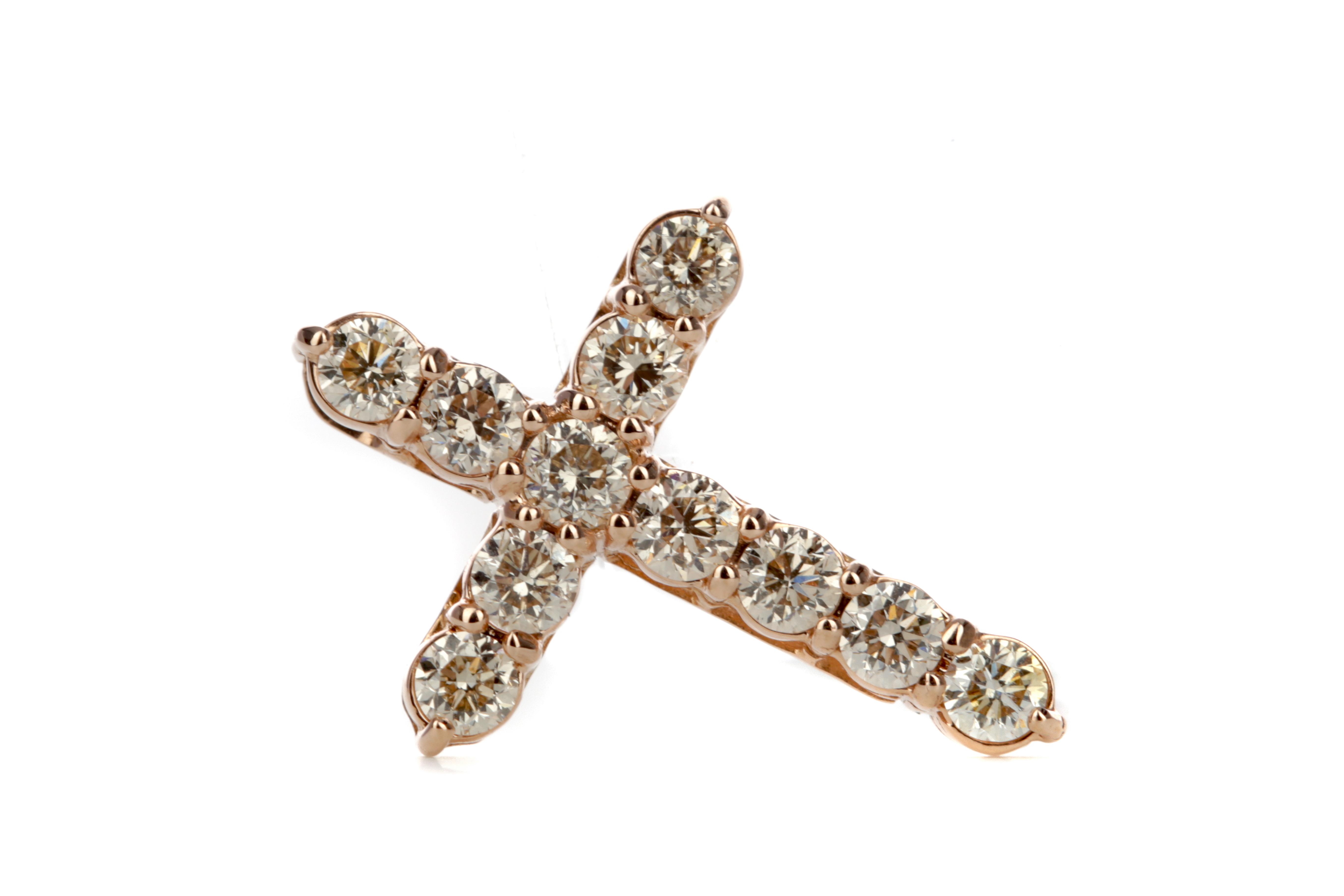 A ROSE GOLD DIAMOND CROSS PENDANT