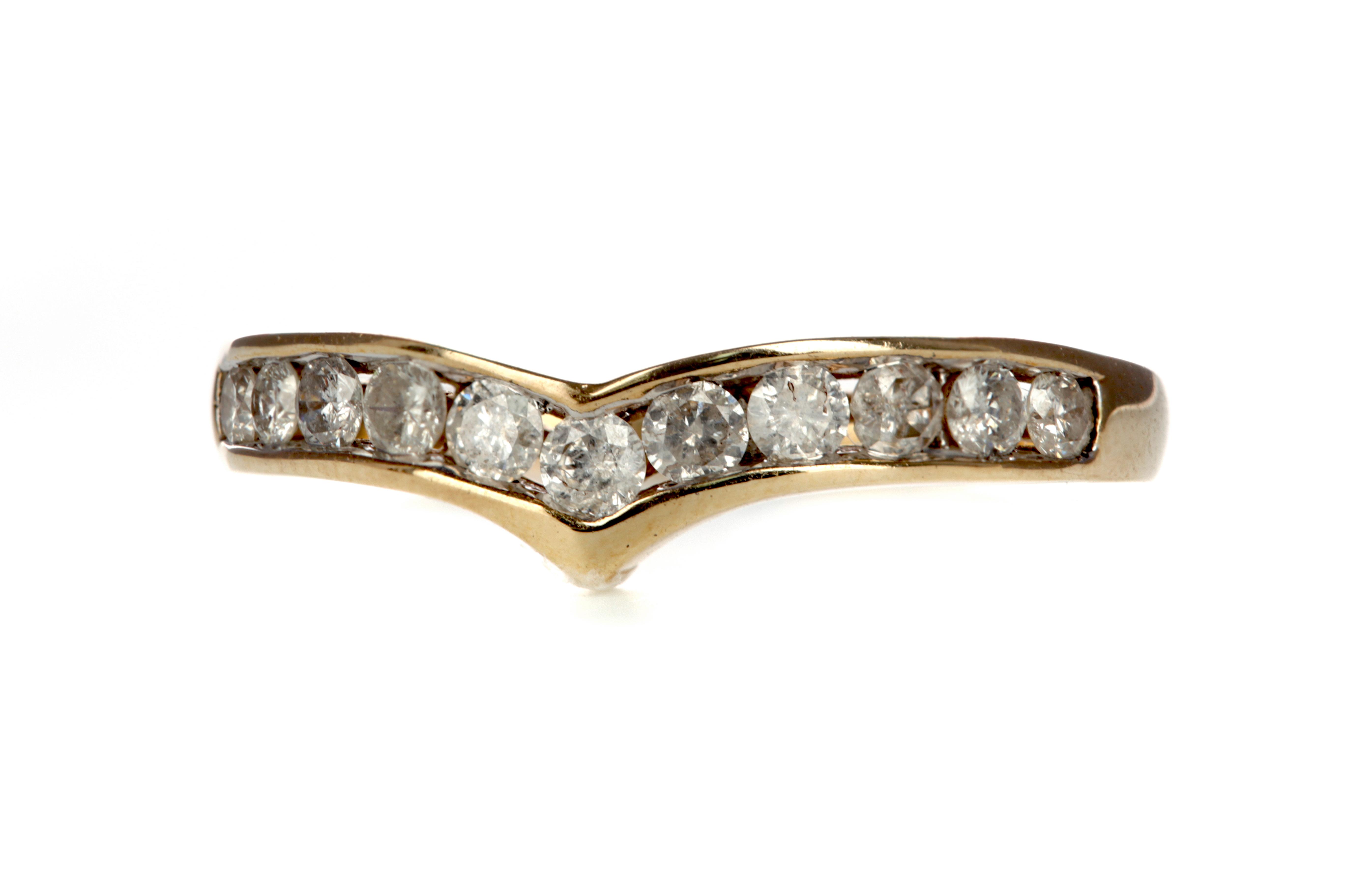 A DIAMOND WISHBONE RING