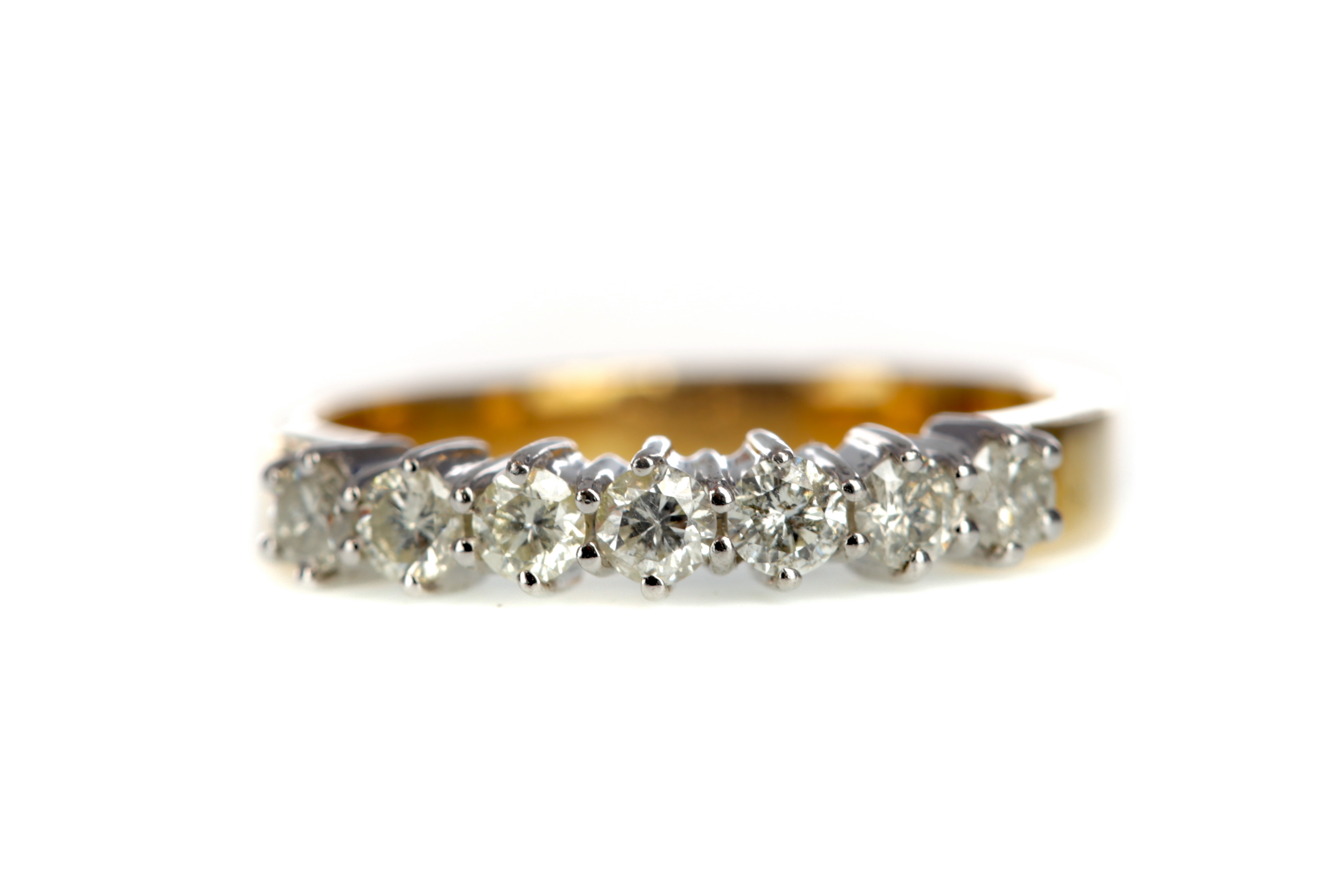 A CERTIFICATED DIAMOND SEVEN STONE RING