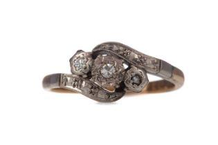 A PARTIAL DIAMOND THREE STONE RING