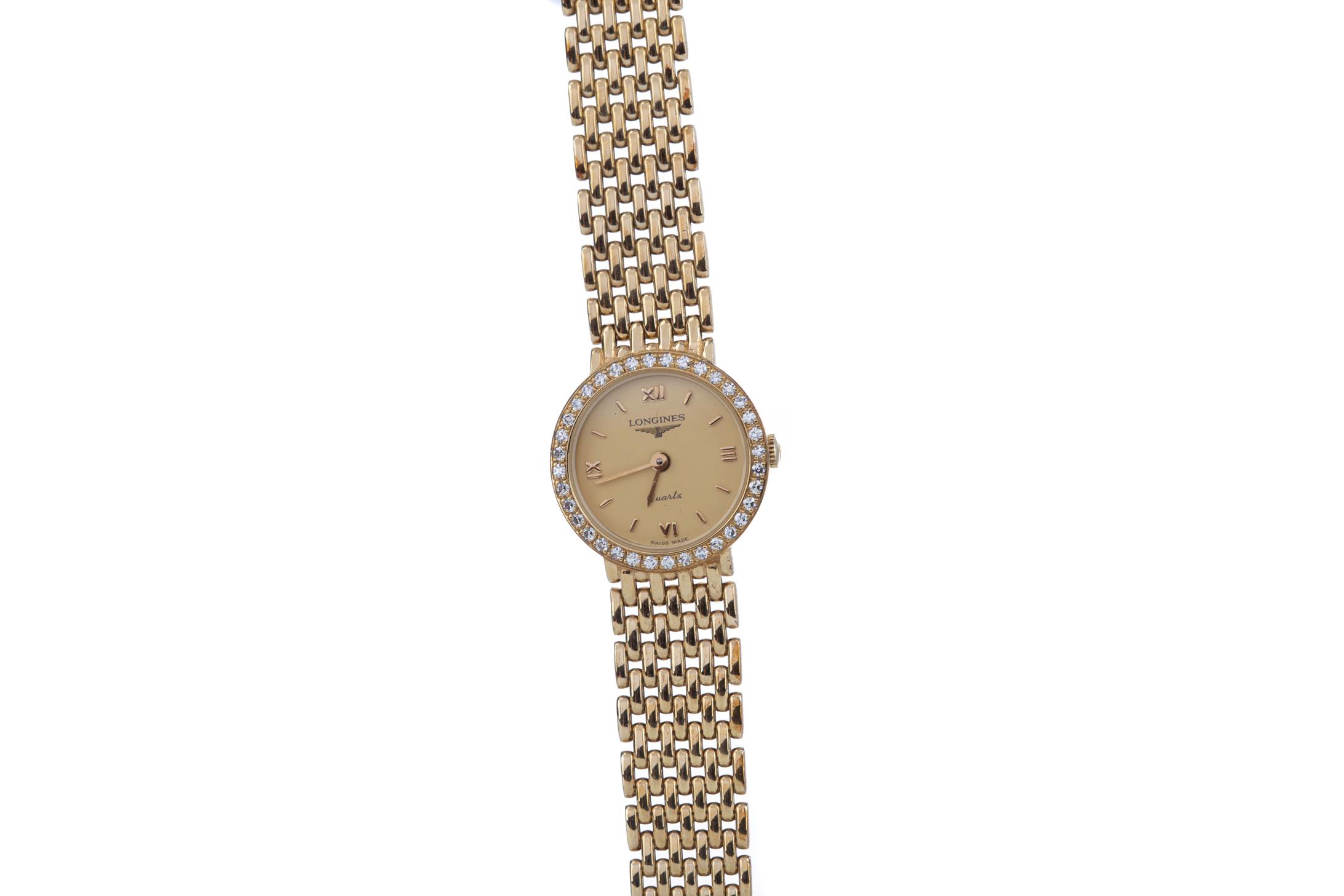 LADY'S LONGINES DIAMOND SET NINE CARAT GOLD QUARTZ WRIST WATCH, the round gold coloured dial with