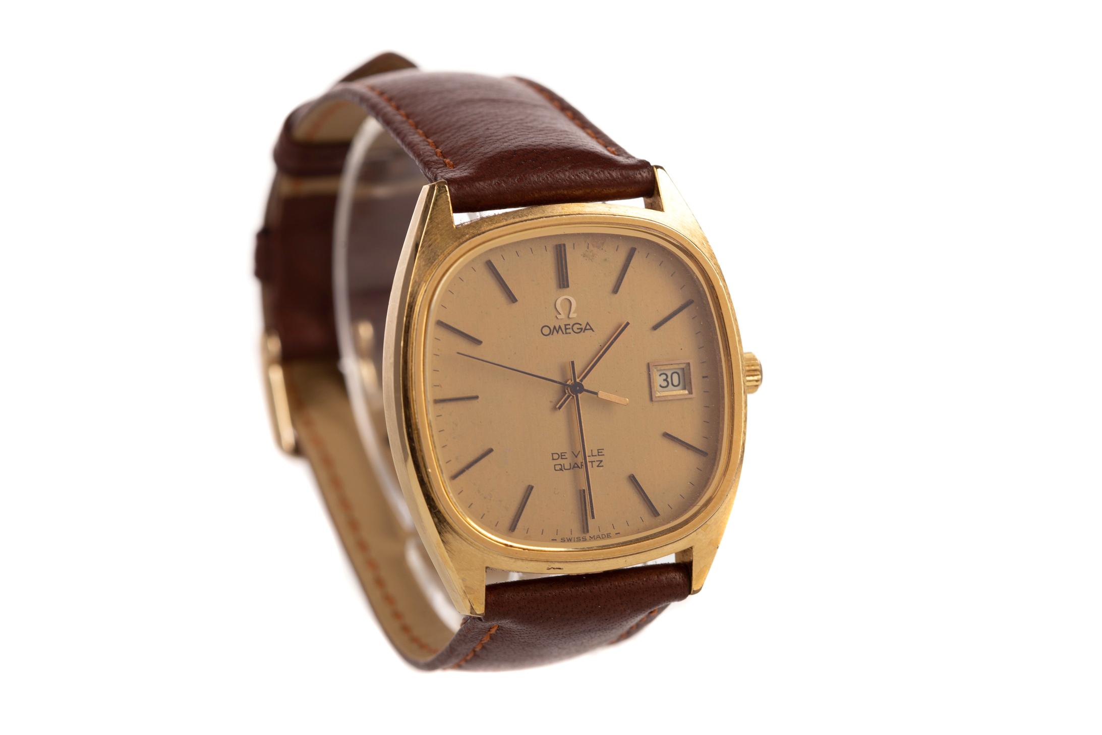 GENTLEMAN'S OMEGA DE VILLE GOLD PLATED QUARTZ WRIST WATCH, the gold coloured cushion shaped dial