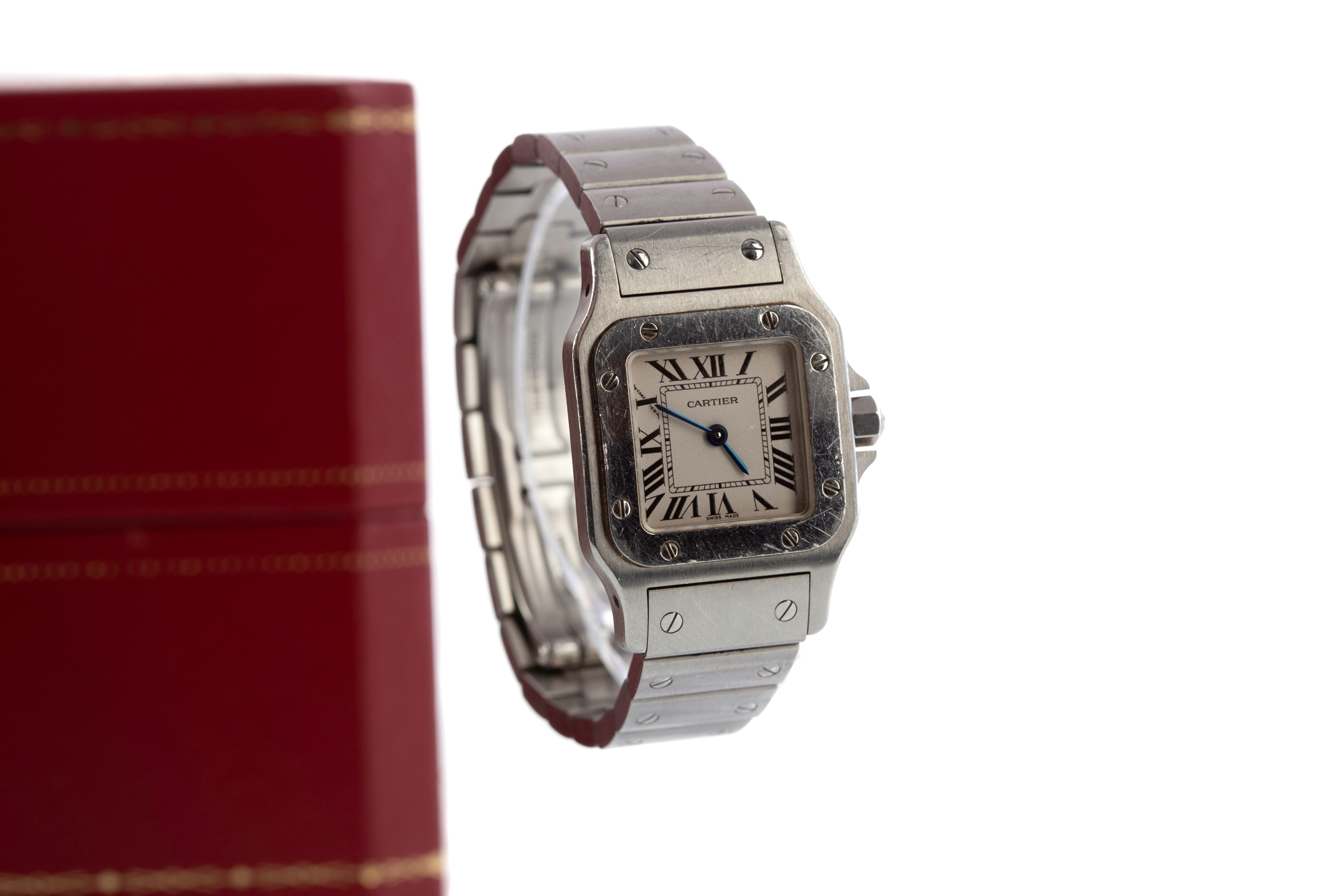 CARTIER SANTOS STAINLESS STEEL QUARTZ WRIST WATCH, the square white dial with Roman hour markers,