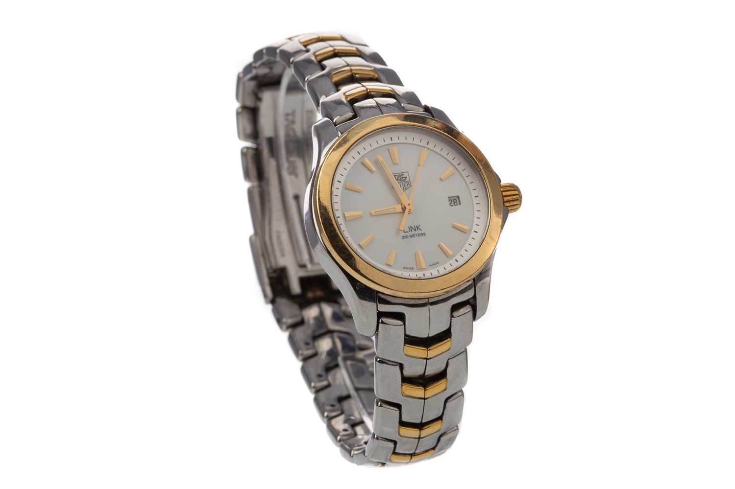A LADY'S TAG HEUER LINK STAINLESS STEEL QUARTZ WRIST WATCH