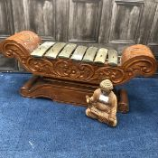 A CARVED WOOD GONG AND A BUDDHA