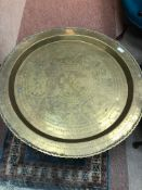 AN EASTERN BRASS TOPPED TABLE