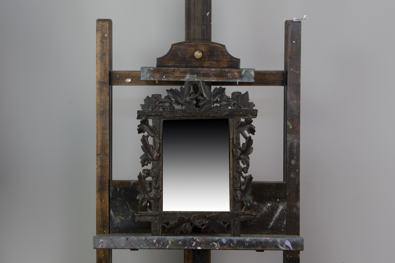 AN EARLY 20TH CENTURY BLACK FOREST WALL MIRROR