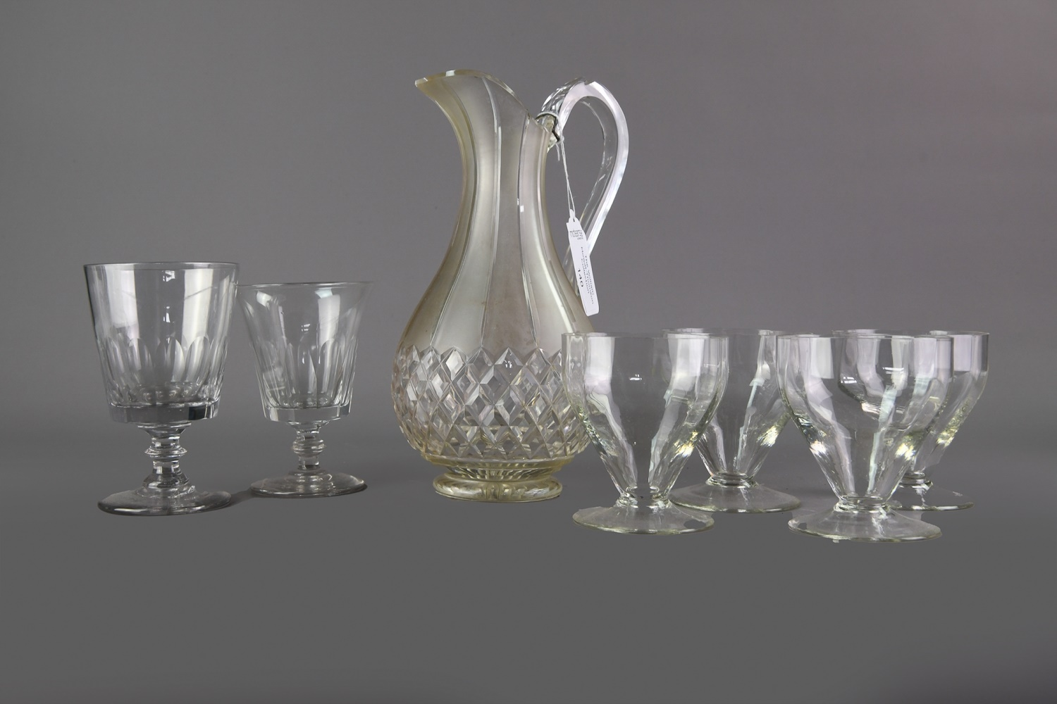 A COLLECTION OF SIX GLASS RUMMERS, ALONG WITH A JUG