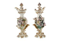 A PAIR OF EARLY 19TH CENTURY DERBY PORCELAIN EWERS AND STOPPERS