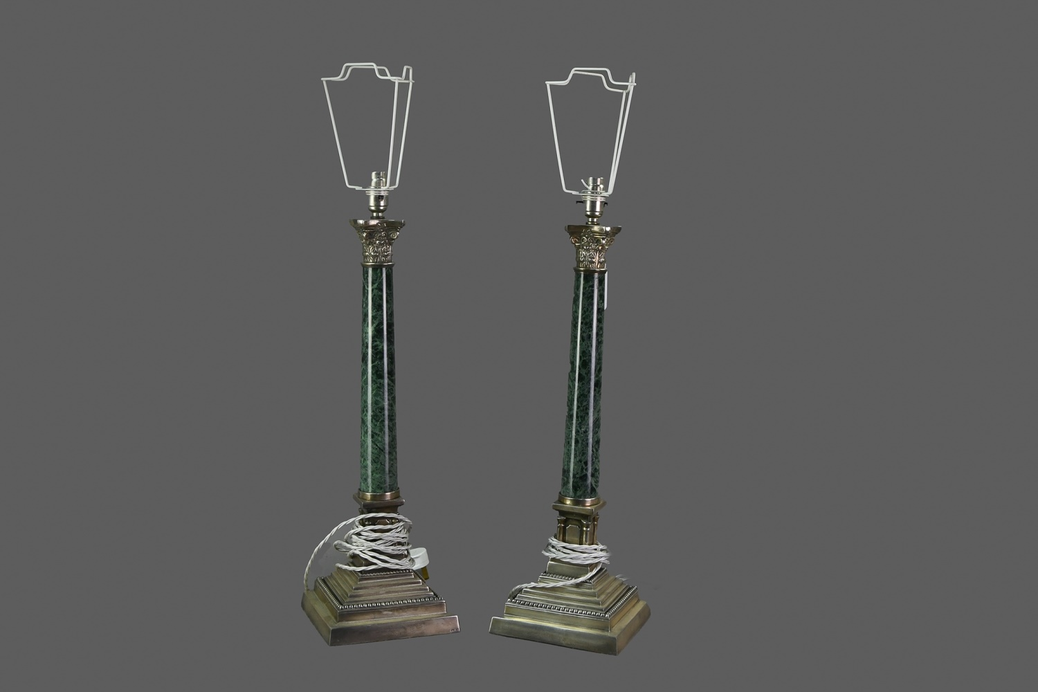 A PAIR OF GREEN MARBLE AND SILVER PLATED CORINTHIAN COLUMN TABLE LAMPS