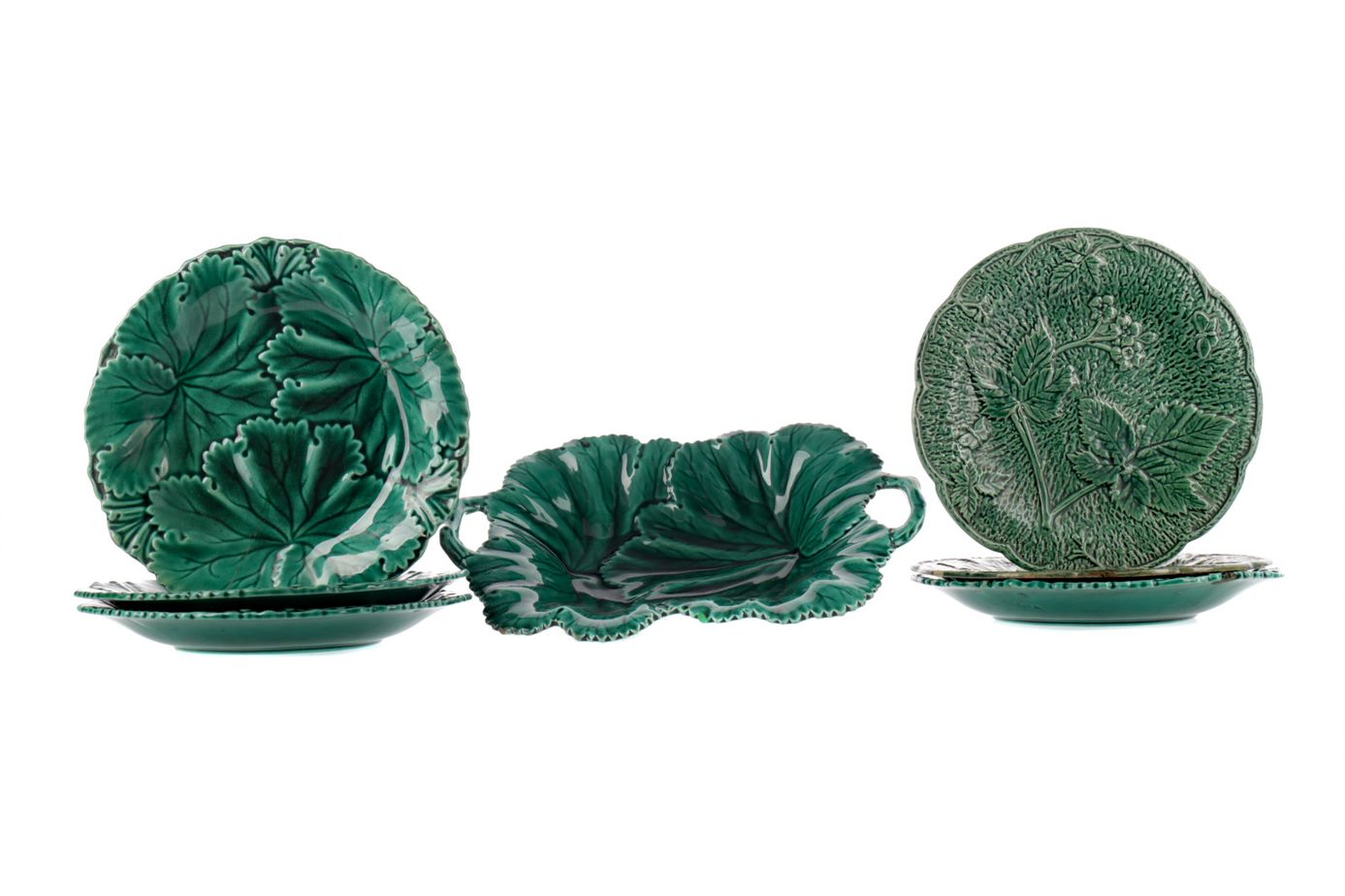 A COMPOSITE SET OF MID-19TH CENTURY LEAF MOULDED PLATES, ALONG WITH A SERVING DISH