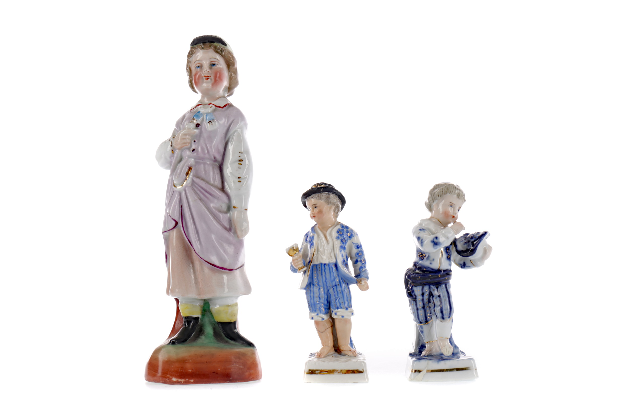 A LATE 19TH CENTURY SITZENDORF PORCELAIN FIGURE OF A BOY, AND TWO OTHERS