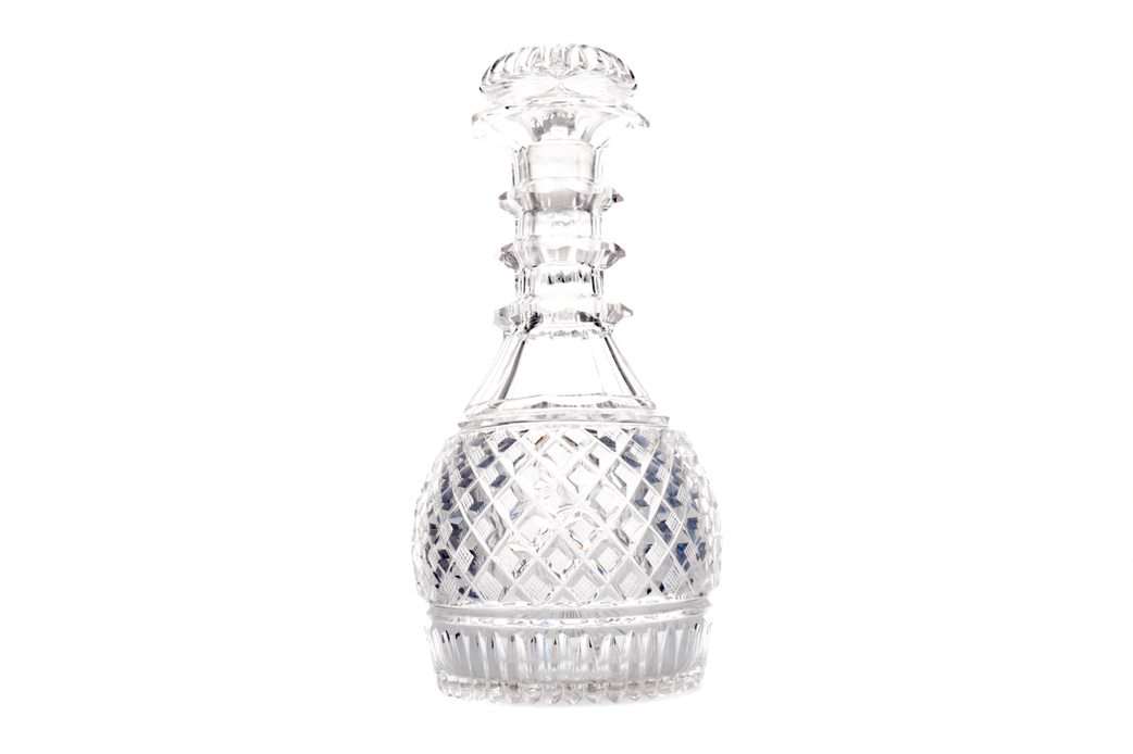 AN EARLY 19TH CENTURY CUT GLASS DECANTER