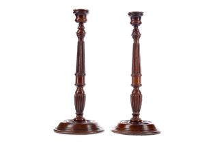 A PAIR OF GEORGE III STYLE MAHOGANY CANDLESTICKS