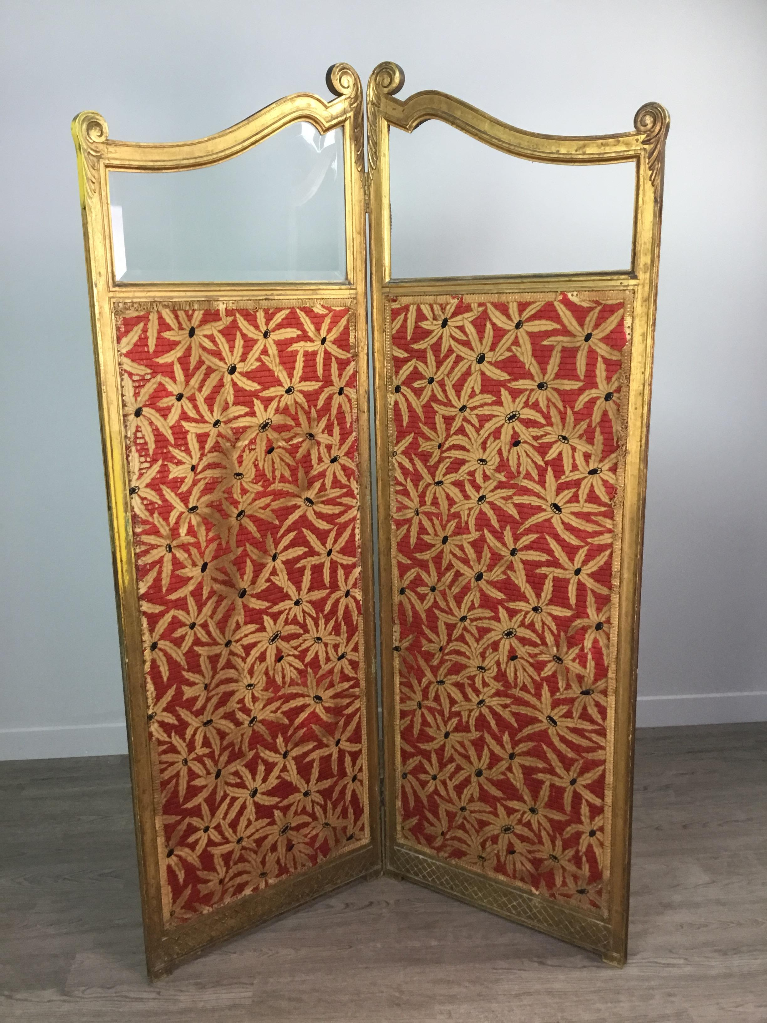 A LATE VICTORIAN GILTWOOD TWO PANEL DRESSING SCREEN