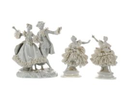 A LATE 19TH CENTURY CONTINENTAL BISCUIT PORCELAIN FIGURE OF A LADY, ALONG WITH