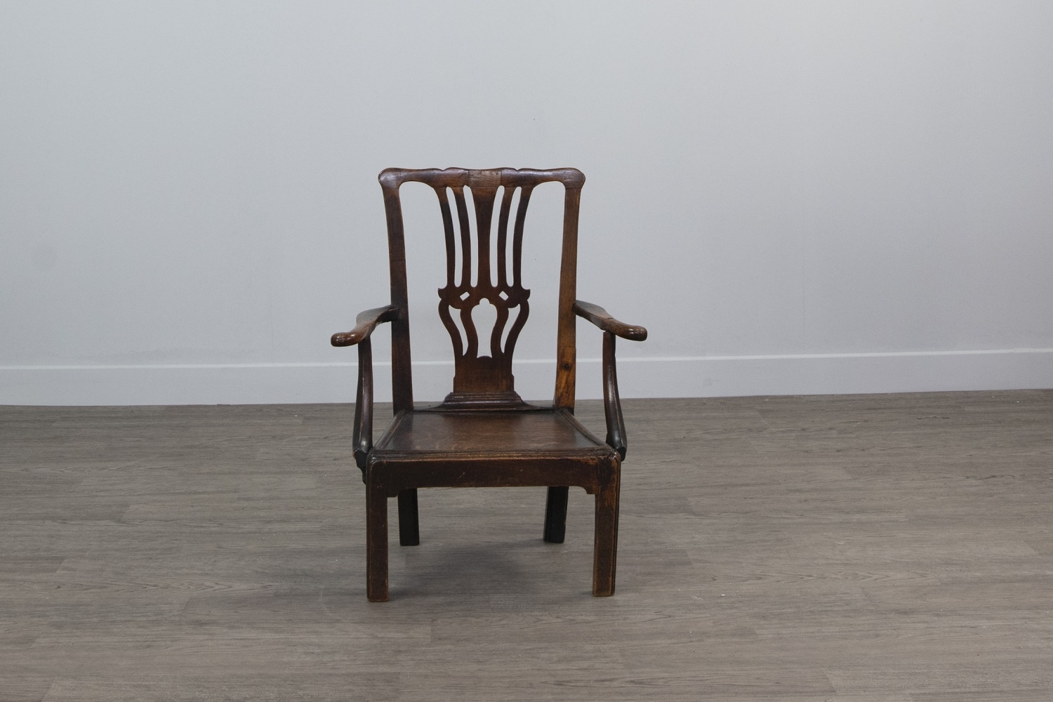 A GEORGE III CHILDS' ELM AND OAK OPEN ELBOW CHAIR