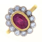 A RUBY AND DIAMOND CLUSTER RING, IN 18CT GOLD, LONDON 1996, 5.1G, SIZE N Good condition