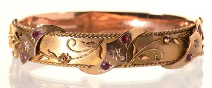 A RUBY AND DIAMOND BANGLE, GIPSY SET AND APPLIED WITH FILIGREE, IN 9CT GOLD, 57 X 71MM, MAKER S BROS