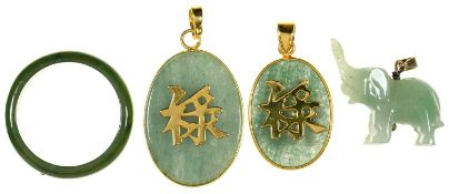TWO CHINESE GOLD MOUNTED JADE DOUBLE SIDED PENDANTS, A JADE ELEPHANT CHARM AND A NEPHRITE RING, ,