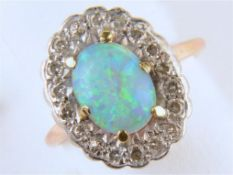AN OPAL AND DIAMOND CLUSTER RING, IN GOLD, UNMARKED, HEAD 12 X 16MM, 3.4G SIZE L Opal polish dull