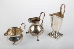 THREE SILVER CREAM JUGS, HELMET SHAPED EXAMPLE 12CM H, ALL BIRMINGHAM, BY VARIOUS MAKERS, 1898, 1900