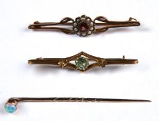 A GOLD STICKPIN WITH OPAL TERMINAL AND TWO GEM SET GOLD BAR BROOCHES, ALL C1900, ONE MARKED 9CT,