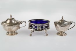 A GEORGE III PIERCED OVAL SILVER SALT CELLAR, BLUE GLASS LINER, CRESTED, 80MM L, MARKS RUBBED, BY