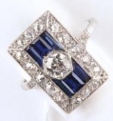 AN ART DECO DIAMOND AND SYNTHETIC SAPPHIRE RECTANGULAR CLUSTER RING, WITH CALIBRE AND OLD CUT