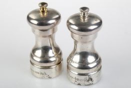 A GRADUATED PAIR OF ELIZABETH II SILVER SALT AND PEPPER MILLS, 10 AND 10.5CM H, BY A J POOLE,