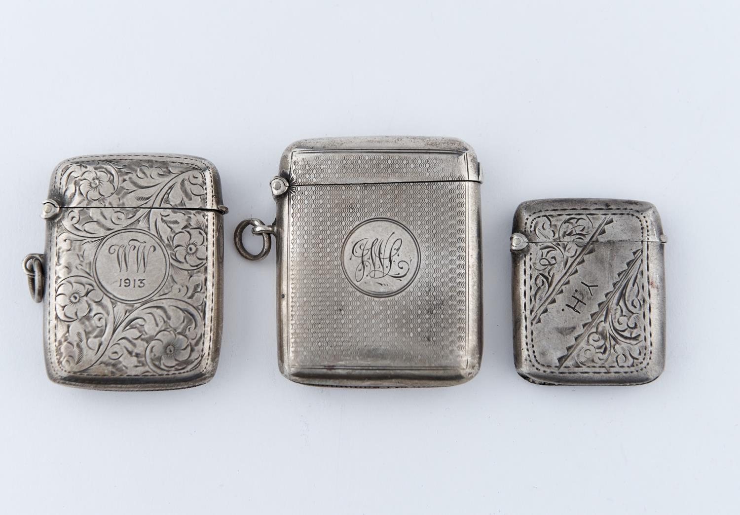 ONE GEORGE V AND TWO EDWARDIAN SILVER VESTA CASES, VARIOUS SIZES, MAKERS AND DATES, 2OZS 9DWTS
