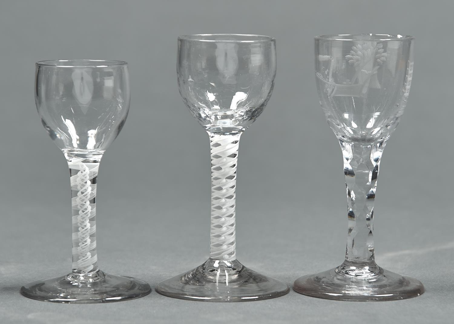 THREE ENGLISH DRINKING GLASSES, C1770, COMPRISING A FACETED STEM GLASS, THE OVOID BOWL ENGRAVED WITH