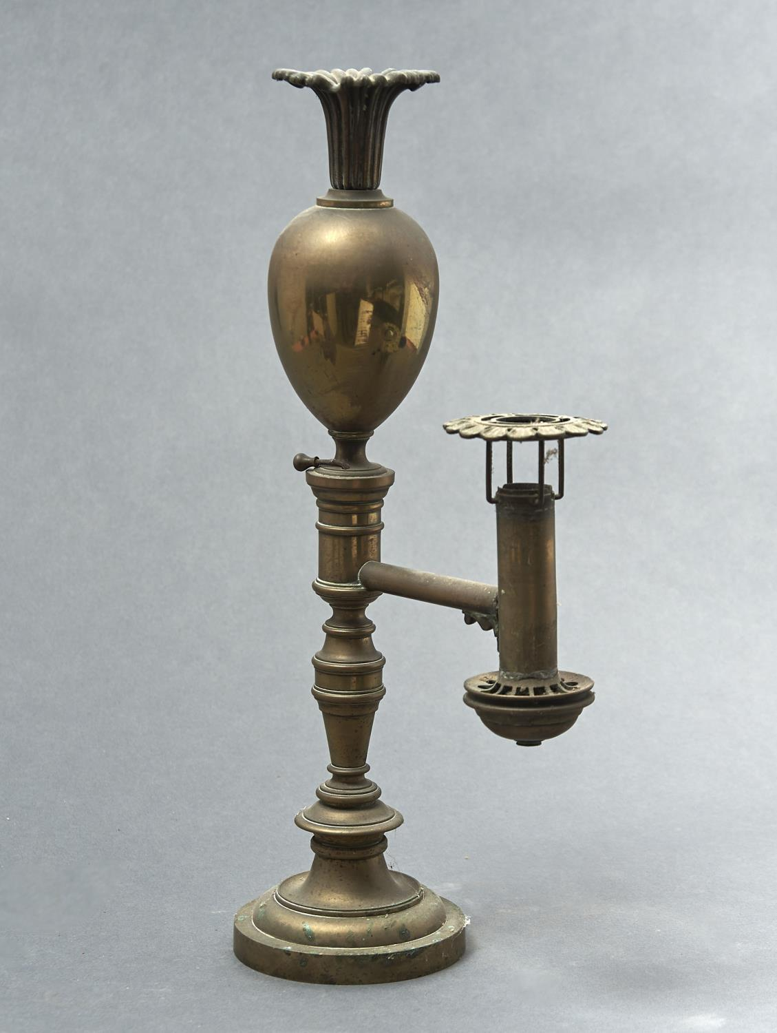 A WILLIAM IV BRASS COLZA LAMP, C1830, OF OVOID FORM WITH FLARED NECK, THE ARM WITH FLORIFORM KNOP,