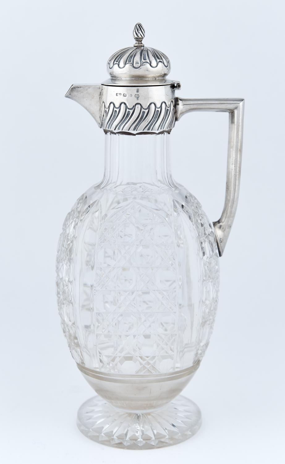 A VICTORIAN SILVER MOUNTED CUT GLASS CLARET JUG, WITH WRYTHEN FLUTED BIRD'S KNOP, BUN LID AND