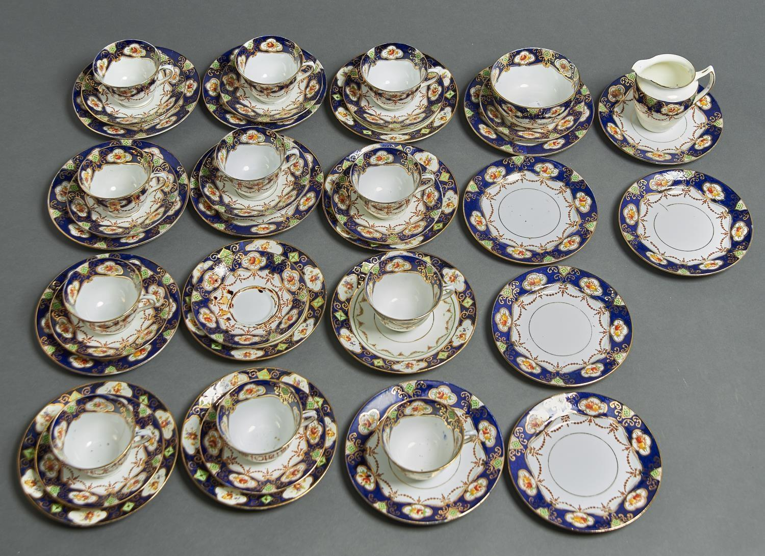 A FIELDINGS TEA SERVICE, PRINTED AND PAINTED WITH RIBBON TIED HAREBELLS WITHIN A BORDER OF FLORAL