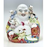 A CHINESE FAMILLE ROSE FIGURE OF BUDAI, 20TH C, WITH COLOURFUL YELLOW, BLUE AND RED ROBES WITH LOTUS