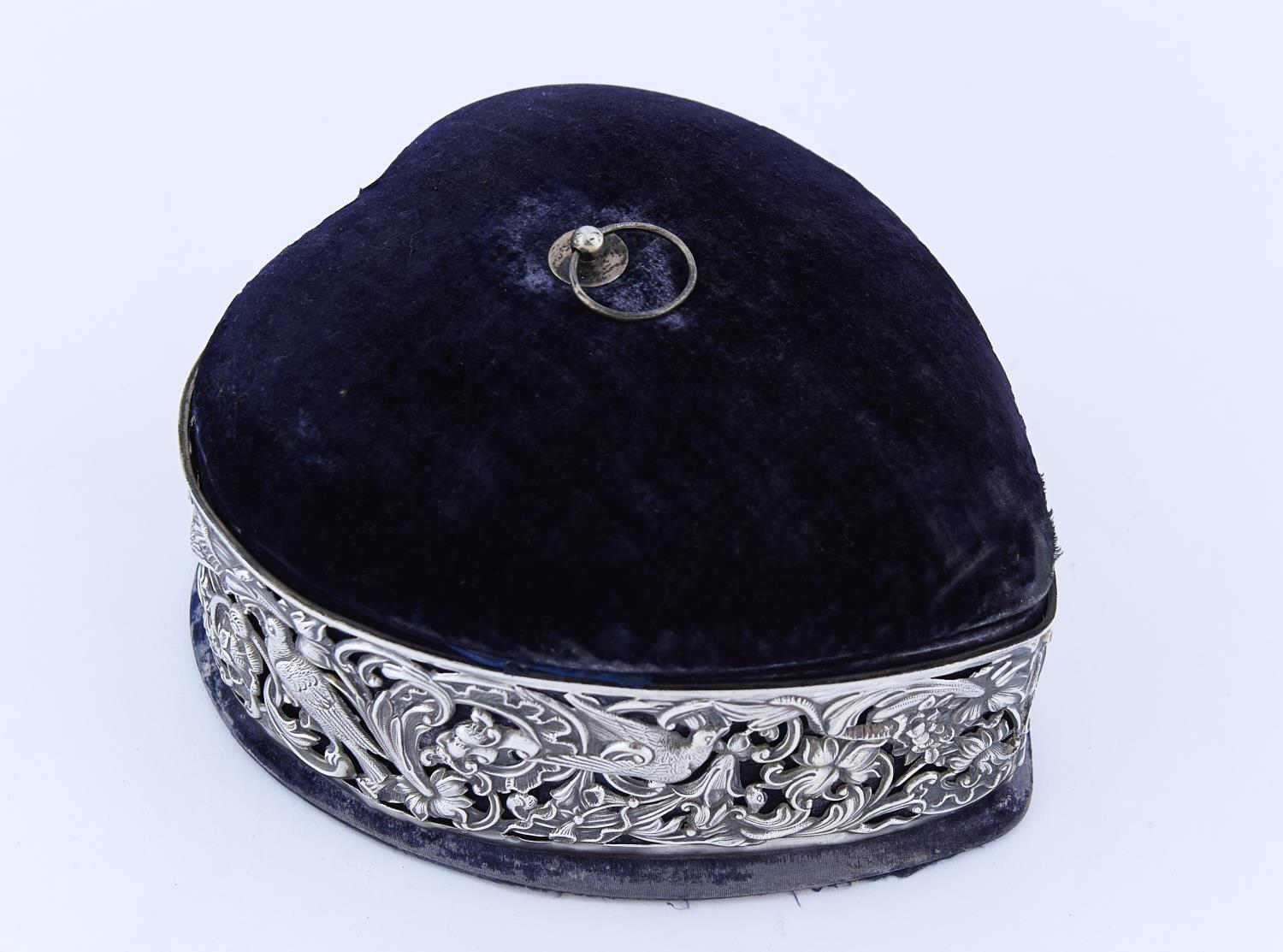 A VICTORIAN HEART SHAPED SILVER AND VELVET JEWEL BOX, WITH DIE STAMPED OPENWORK SLEEVE OF BIRDS
