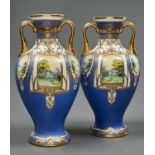 A PAIR OF NORITAKE VASES, EARLY 20TH C, WITH UPSWEPT GILT SHOULDER HANDLES, PAINTED WITH RURAL