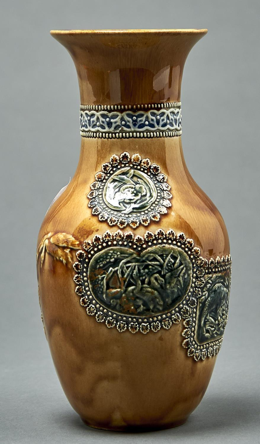 AN AESTHETIC DOULTON WARE VASE, C1880, MOULDED IN RELIEF WITH BIRDS IN FLIGHT AND DECORATED BY