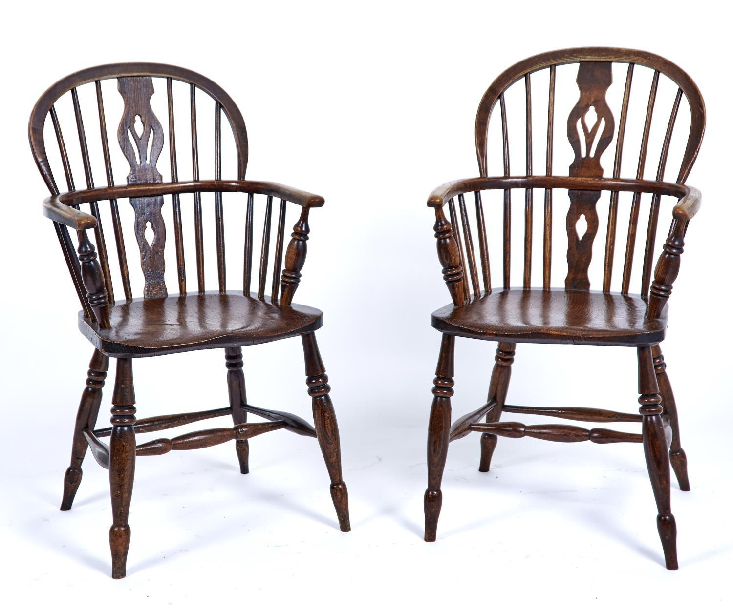A PAIR OF ASH AND ELM WINDSOR ELBOW CHAIRS, MID 19TH C, PIERCED SPLATS FLANKED BY SPINDLES, DISHED