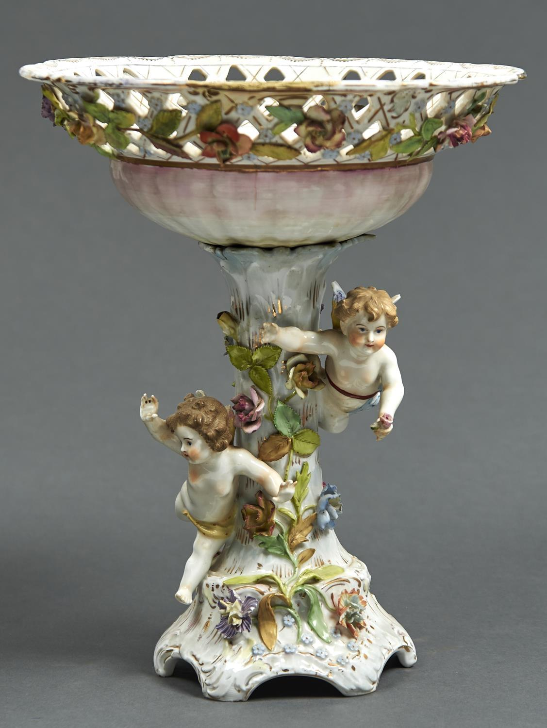A POTSCHAPPEL FLORAL ENCRUSTED CENTREPIECE, C1900, THE SHELL SHAPED BOWL WITH TRELLIS BORDER ON